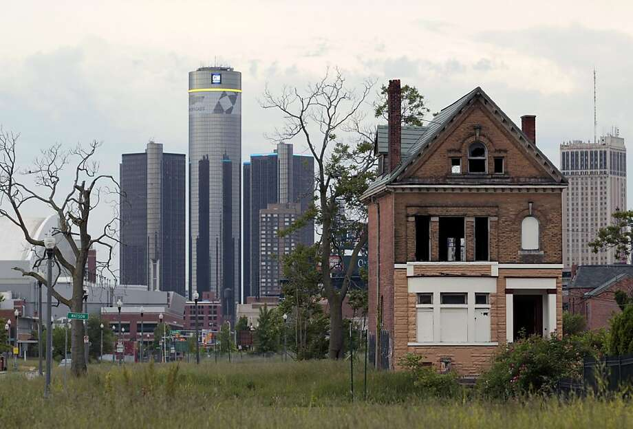 General Motors, headquartered in the Renaissance Center (rear), is staying, but many have left Detroit. A population that was 1.8 million in the 1950s now struggles to stay above 700,000. Photo: Jeff Kowalsky, Bloomberg