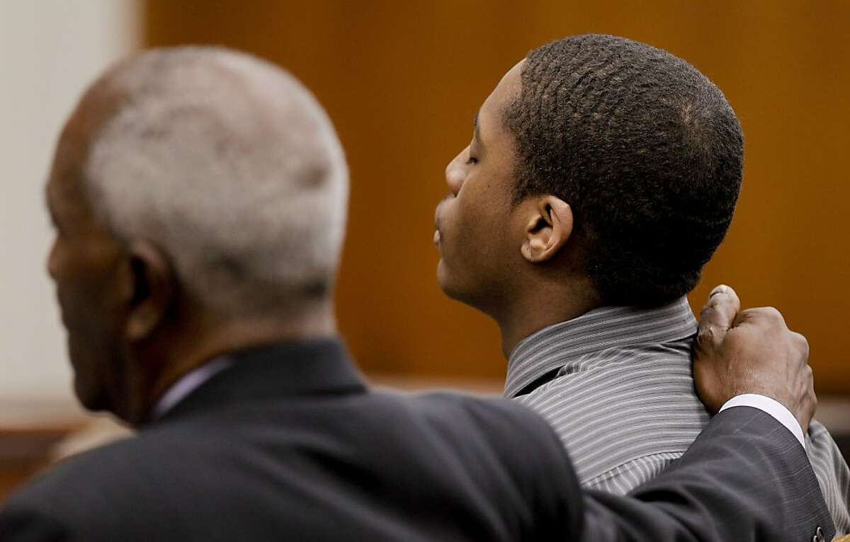 Marcelles Peter (right) receives support from his attorney, Gordon Brown, as the jury convicts him in the gang rape.