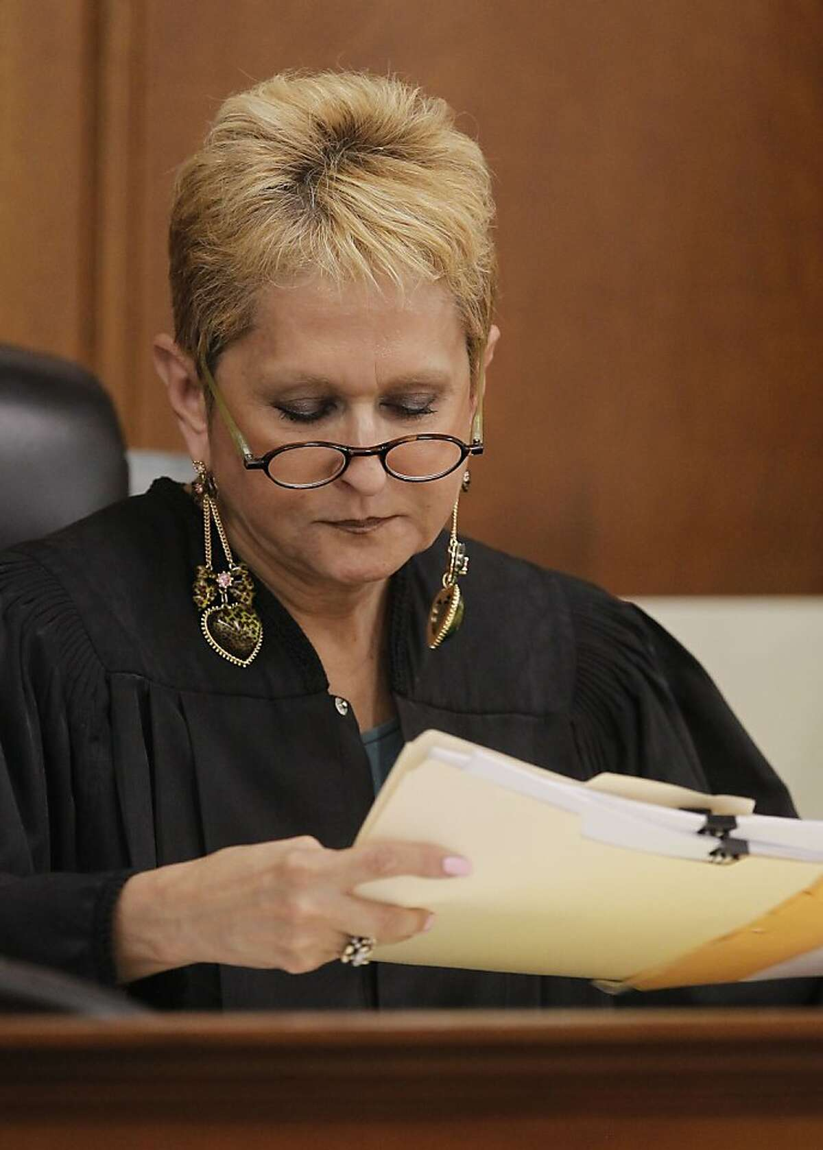 Judge Barbara Zuniga reads over the jury verdicts, at the Contra Costa County Courthouse in Martinez, Calif 18, 2013, against defendants Jose Carlos Montano and Marcelles Peter charged in the gang-rape of a 16 year old girl at Richmond High School in October of 2009,