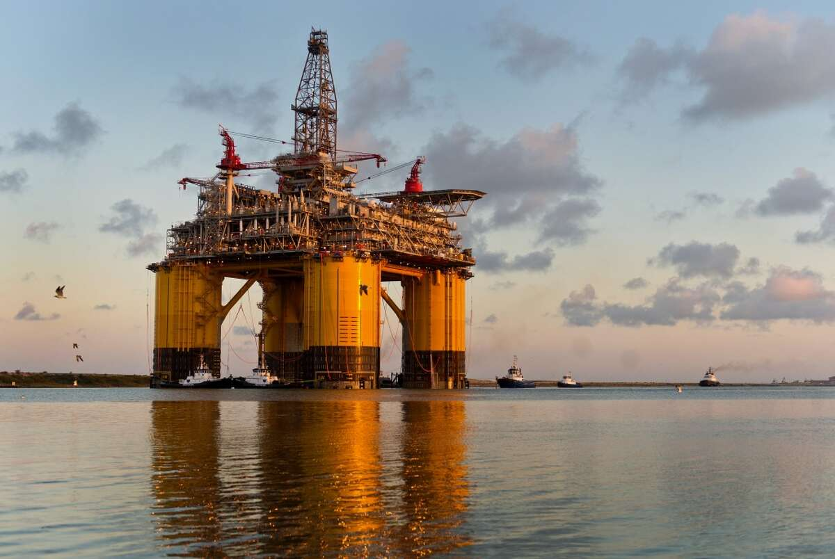 The Royal Dutch Shell Plc Olympus tension leg platform (TLP) is seen at dawn as it sets sail from Kiewit Offshore Services in Ingleside, Texas, U.S., on Saturday, July 13, 2013. Olympus, Shell's biggest constructed tension leg platform, started the ten day, 425-mile voyage to Mars B Field in the Gulf of Mexico on July 13. Photographer: Eddie Seal/Bloomberg