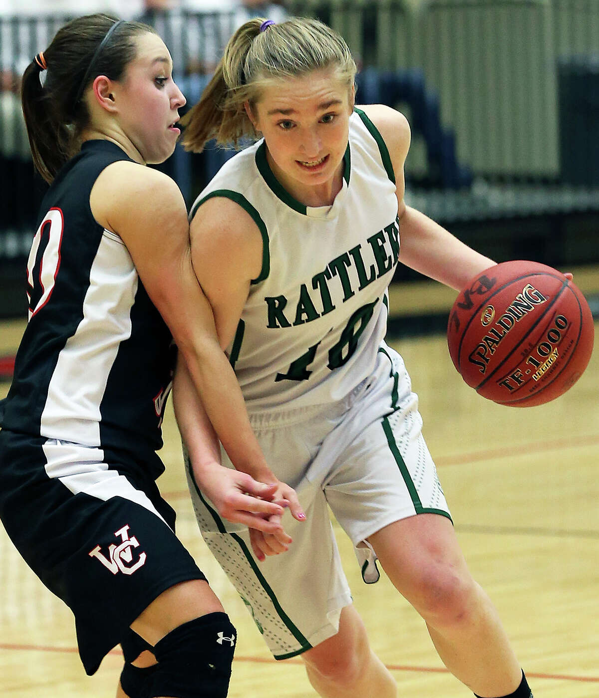 Wendy Knight pushes into the key against the Chargers' Bailee Weinheimer as the Reagan girls play Churchill at Littleton Gym on January 15, 2013.