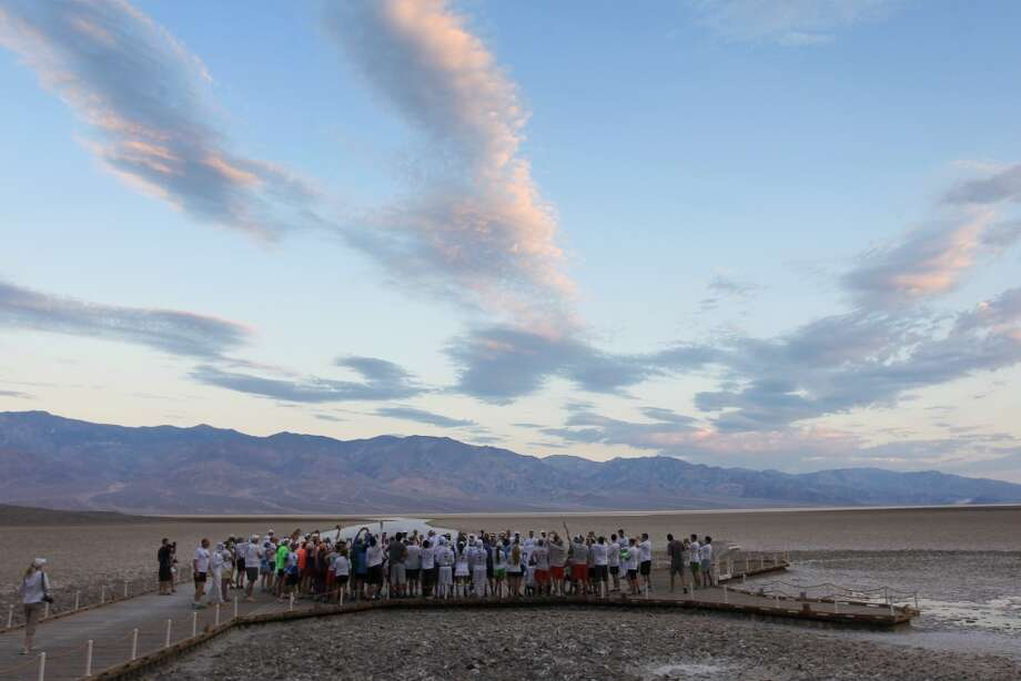 Runners gather at Badwater Basin for the start of the AdventureCORPS Badwater 135 ultra-marathon race on July 15, 2013 in Death Valley National Park, California.