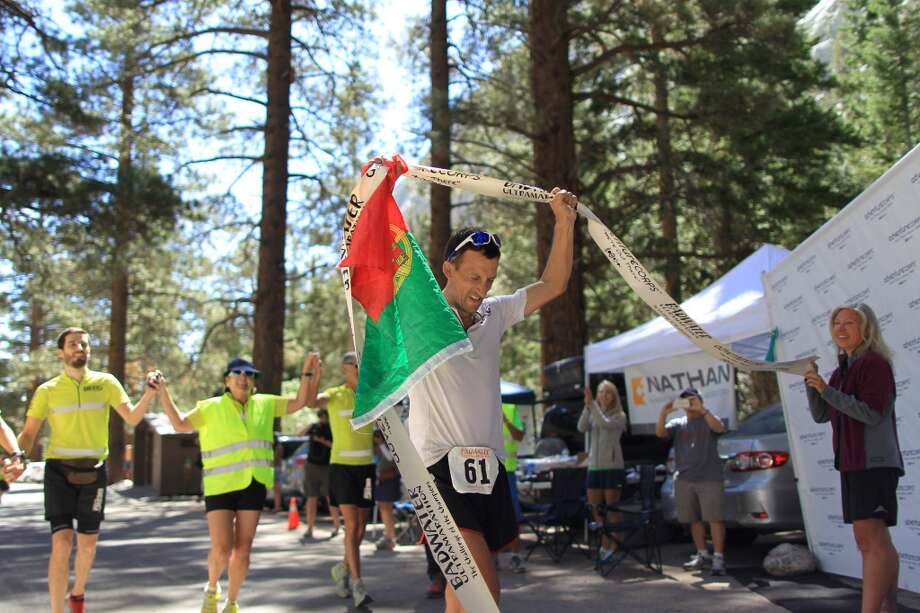 Carlos Alberto Gomas De Sa from Portugal, a first-time competitor in the event, reaches the finish line to win the AdventureCORPS Badwater 135 ultra-marathon race on July 16, 2013 outside of Death Valley National Park, California.