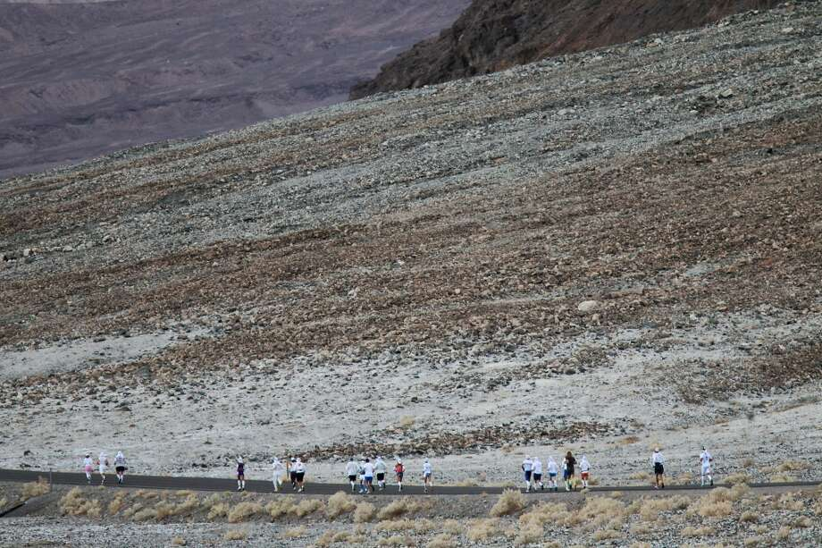 The first wave of runners leaves Badwater Basin during the AdventureCORPS Badwater 135 ultra-marathon race on July 15, 2013 in Death Valley National Park, California.