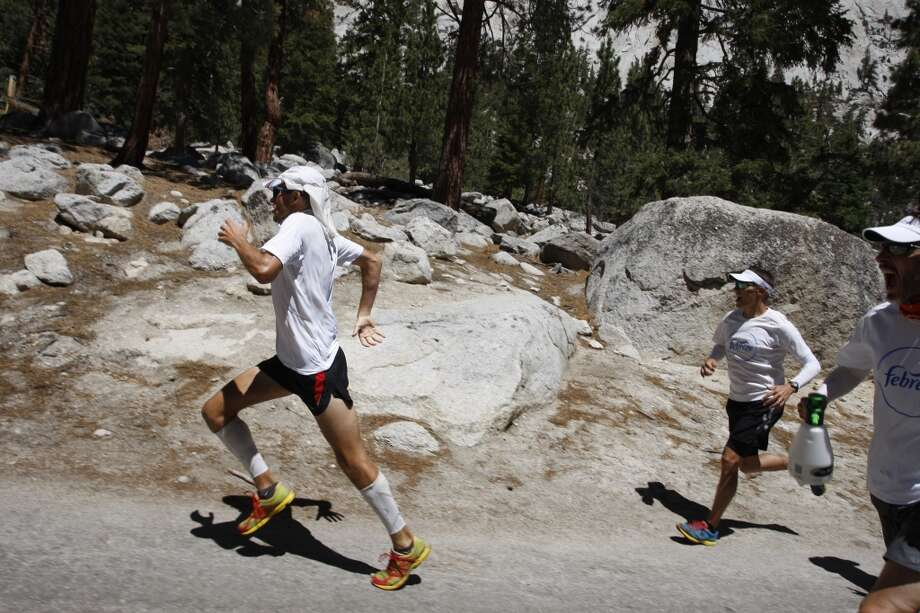 Harvey Sweetland Lewis III sprints hard, leaving his support crew behind, toward the finish to take fourth place in the AdventureCORPS Badwater 135 ultra-marathon race on July 16, 2013 outside of Death Valley National Park, California.