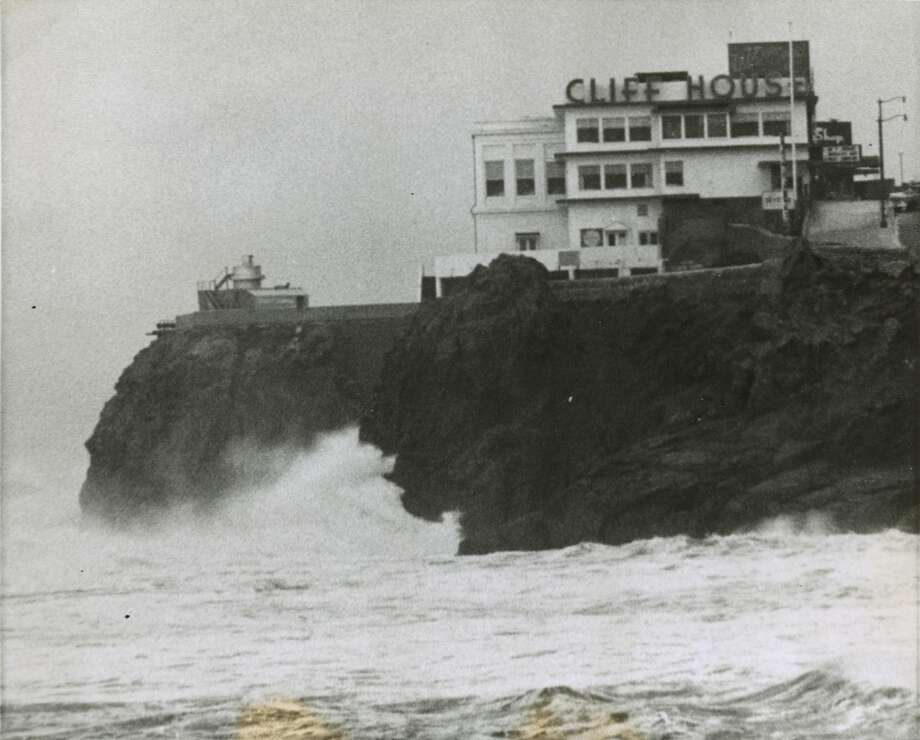 Dec 28, 1965 — Big waves pound the base of the Cliff House, famed San Francisco oceanside restaurant, as a storm approaches.