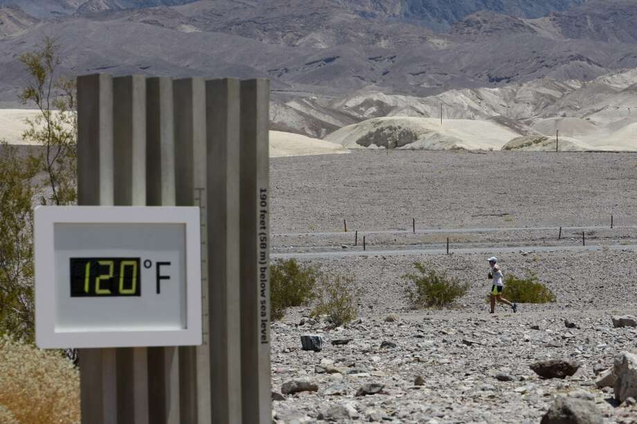 A competitor passes the unofficial thermometer at Furnace Creek Visitor Center during the AdventureCORPS Badwater 135 ultra-marathon race on July 15, 2013 in Death Valley National Park, Calif.