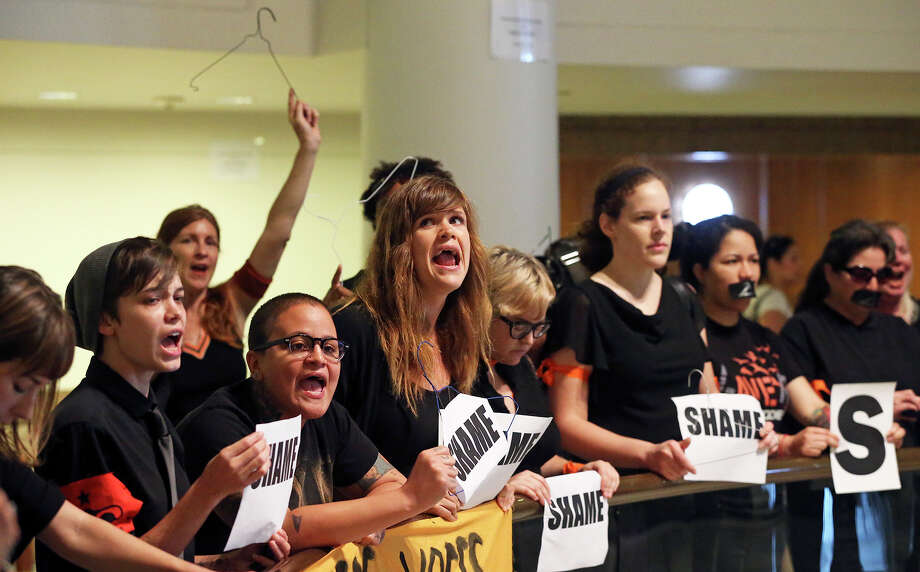 Protestors chant as Governor Rick Perry signs into law the abortions restrictions bill  on July 18, 2013. Photo: Tom Reel, San Antonio Express-News