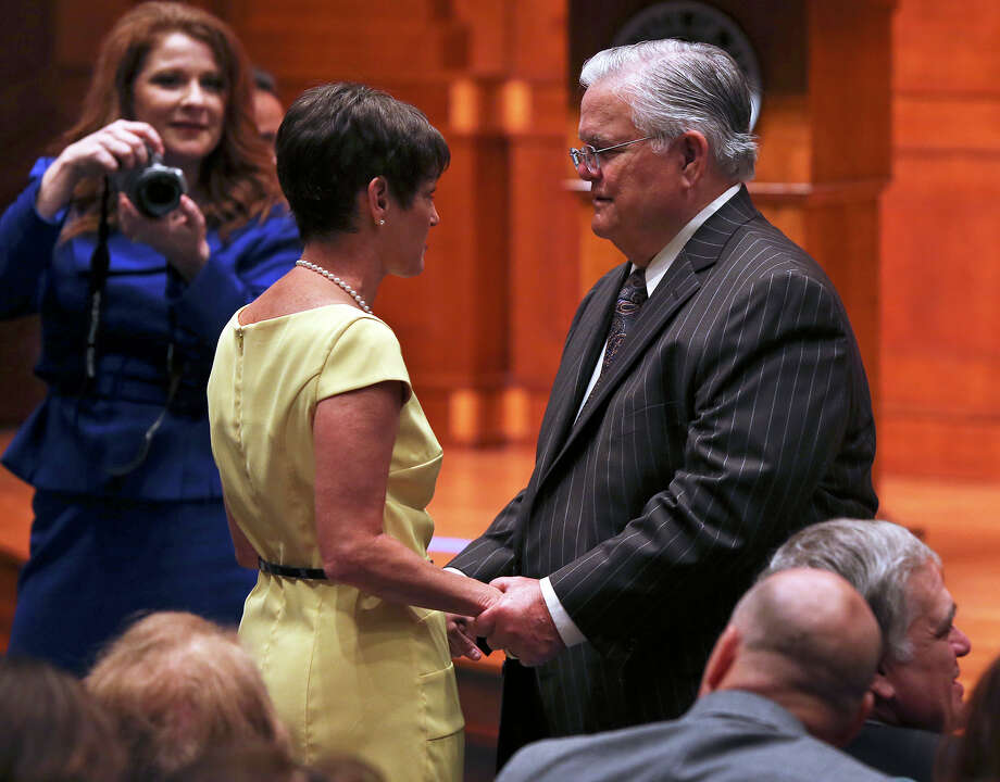 State Sen. Donna Campbell, R-New Braunfels, is greeted by Pastor John Hagee before Gov. Rick Perry signs into law the abortions restrictions bill  on July 18, 2013. Photo: Tom Reel, San Antonio Express-News