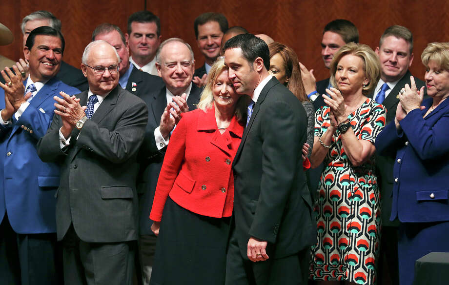 Bill sponsors Jodie Laubenberg and Glenn Hegar hug after being recognized as Governor Rick Perry signs into law the abortions restrictions bill  on July 18, 2013. Photo: Tom Reel, San Antonio Express-News