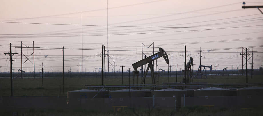 Countable power lines and pump jacks dot the horizon in the Permian Basin just west of Midland. Photo: San Antonio Express-News File Photo