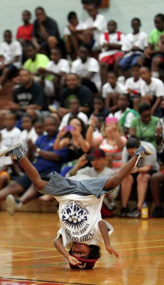 Ekevu Ashe, 6, performs with fellow Break Free Community Center dancers during the opening ceremony of the Harris County Street Olympics Three On Three Tournament at Fonde Recreation Center on Thursday, July 18, 2013, in Houston. Photo: Mayra Beltran / © 2013 Houston Chronicle
