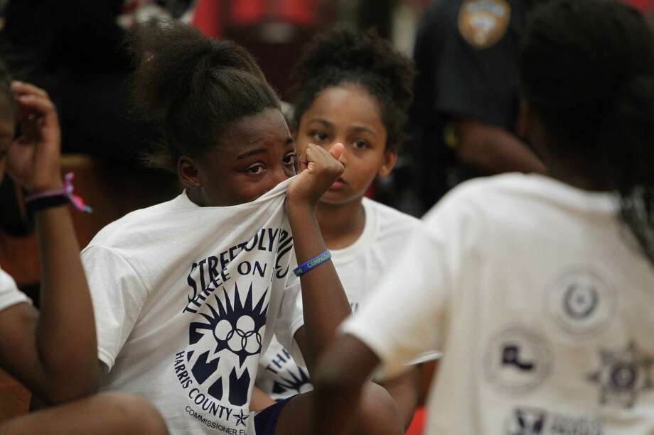 Jakyla Cleveland wipes tears after loosing in the first game of the Three On Three Tournament of the Harris County Street Olympics at Fonde Recreation Center on Thursday, July 18, 2013, in Houston. Photo: Mayra Beltran / © 2013 Houston Chronicle