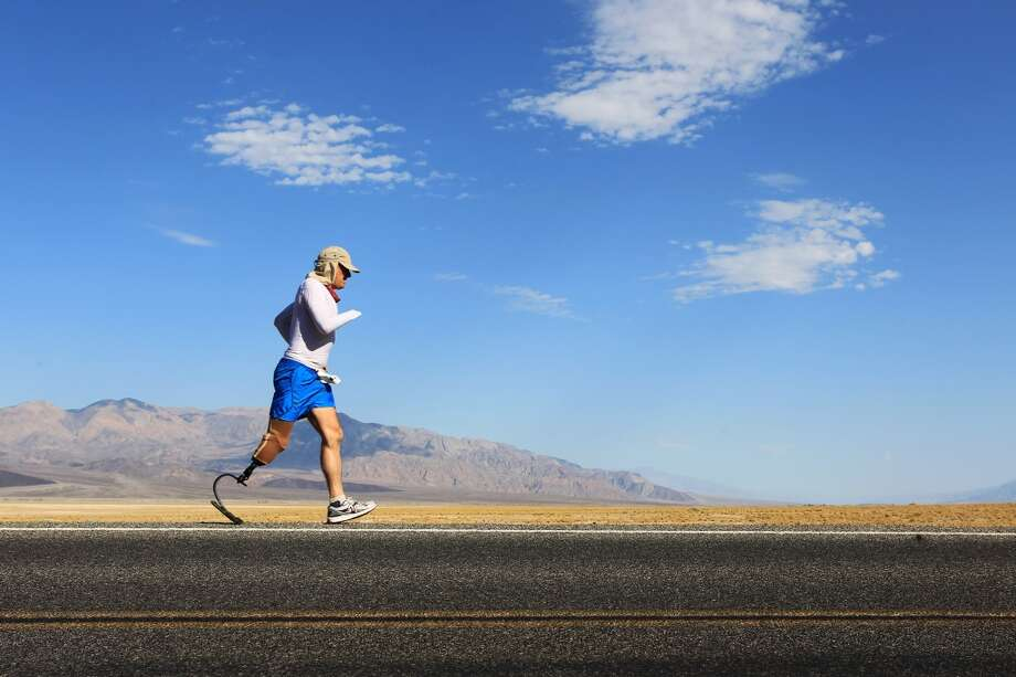 Double amputee Chris Moon of the U.K. runs in the AdventureCORPS Badwater 135 ultra-marathon race on July 15, 2013 in Death Valley National Park, California.
