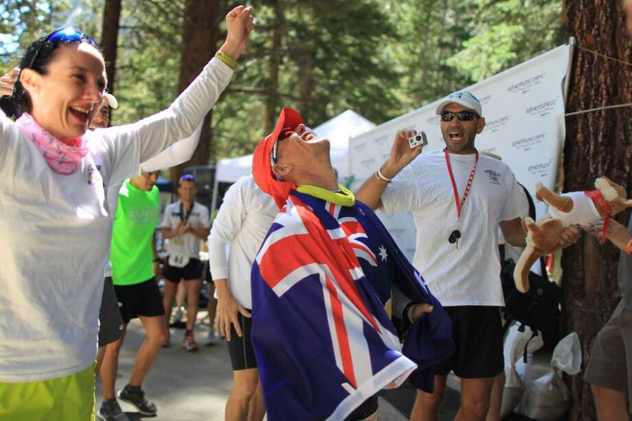 Grant Maighan of Australia, a first-time competitor in the event, reaches the finish line to take second place in the AdventureCORPS Badwater 135 ultra-marathon race on July 16, 2013 outside of Death Valley National Park, California.