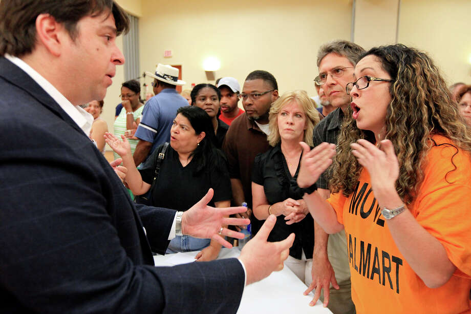 Wal-Mart spokesman Daniel Morales (left) talks with Cibolo resident Tannya Steffen during an open house about the proposed store Thursday July 18, 2013 at the Schertz Civic Center. Photo: Edward A. Ornelas, San Antonio Express-News / © 2013 San Antonio Express-News