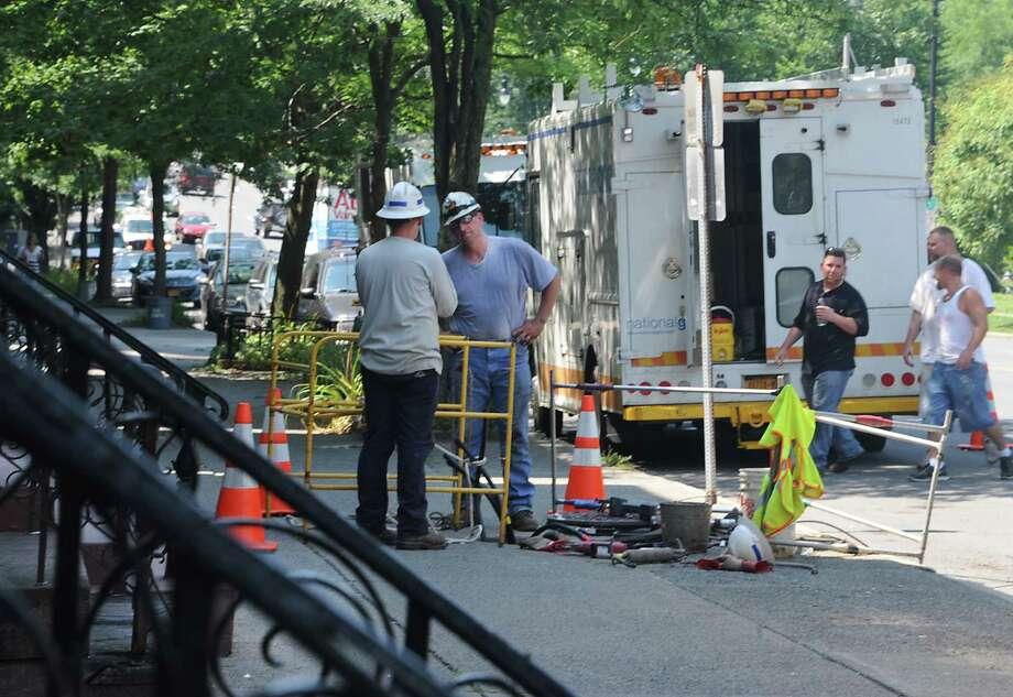 National Grid crews work under a sidewalk along Madison Ave. near Washington Park Wednesday, July 17, 2013, in Albany, N.Y. (Lori Van Buren / Times Union) Photo: Lori Van Buren