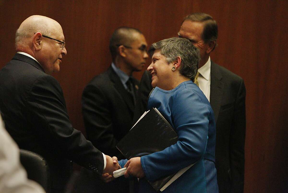 Department of Homeland Security secretary Janet Napolitano (right) shakes hands with UC University of California president Mark Yudof (left), who she will be succeeding, after she was approved to be the next president of the University of California system during a University of California Board of Regents meeting on July 18, 2013 in San Francisco, Calif.