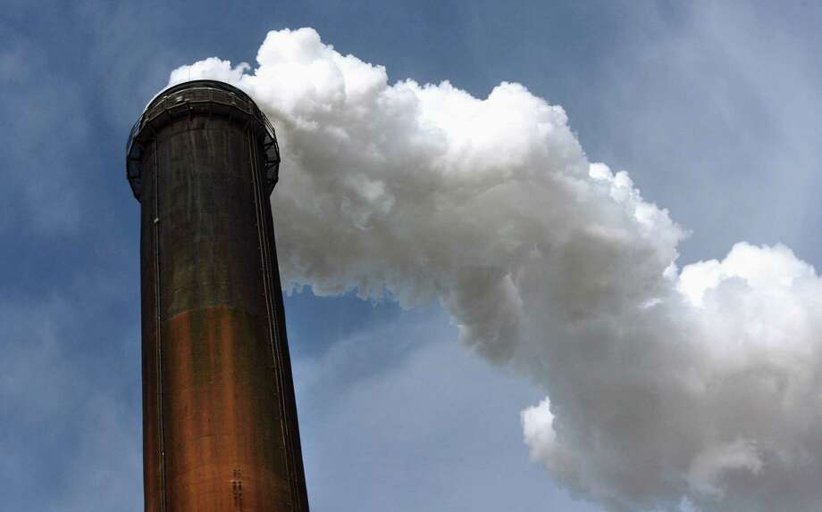 Steam and effluent is dispersed through a smokestack at the City Water, Light & Power's coal-fired power station complex in Springfield, Ill. Photo: David Spencer, MBR / The State Journal-Register