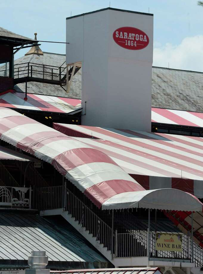 The red and white canvas covers at the Saratoga Race Course in Saratoga Springs, N.Y.   (Skip Dickstein/Times Union) Photo: SKIP DICKSTEIN / 10023129A