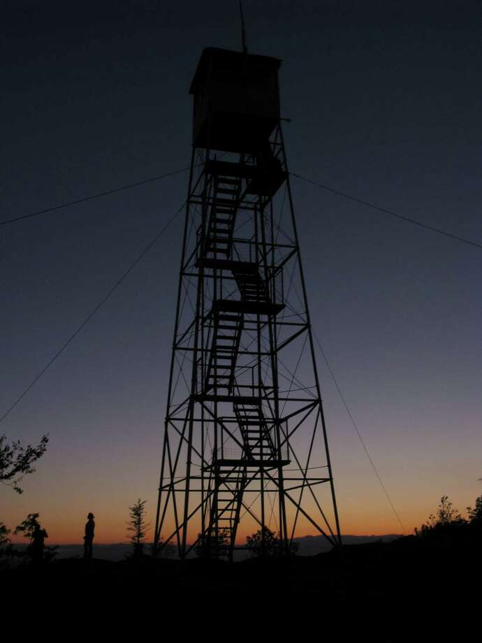 The Hadley Mountain fire tower is shown at sunset. (Herb Terns/Times Union) Photo: Picasa