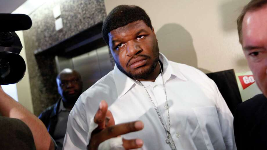 "FILE - In this Dec. 18, 2012 file photo, Dallas Cowboys defensive tackle Josh Brent, center, and his attorney George Miller, obscured at right, leave court in Dallas. Brent says he is retiring from football as he faces trial for a fatal crash that killed a teammate. Brent's agent, Peter Schaffer, said Thursday, July 18, 2013, that the 25-year-old Brent was ""taking care of his priorities."" (AP Photo/David Woo, Pool, File) ORG XMIT: TXDAM201 Photo: David Woo / Pool Dallas Morning News"