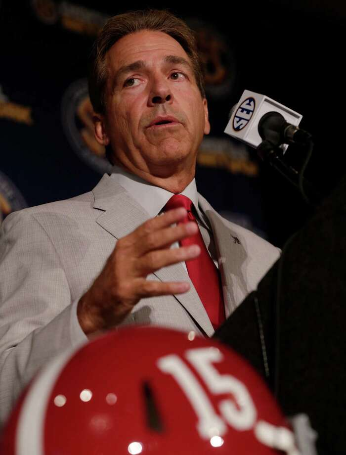 Alabama coach Nick Saban talks with reporters during the Southeastern Conference football Media Days in Hoover, Ala., Thursday, July 18, 2013. (AP Photo/Dave Martin) ORG XMIT: ALDM126 Photo: Dave Martin / AP