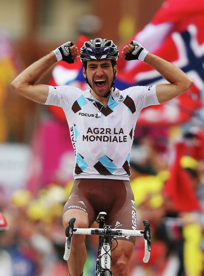 *** BESTPIX *** ALPE D'HUEZ, FRANCE - JULY 18:  Christophe Riblon of France and Team AG2R La Mondiale reacts as he crosses the finish line to win stage eighteen of the 2013 Tour de France, a 172.5KM road stage from Gap to l'Alpe d'Huez, on July 18, 2013 in Alpe d'Huez, France.  (Photo by Bryn Lennon/Getty Images) ORG XMIT: 160066799 Photo: Bryn Lennon / 2013 Getty Images