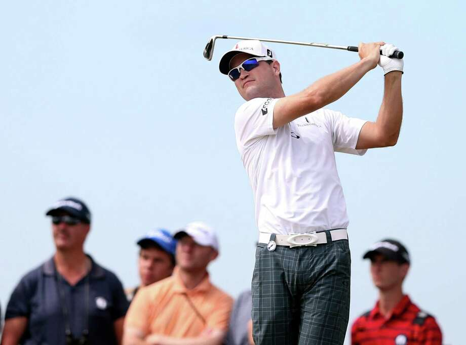 Zach Johnson of the United States plays a shot off the 8th tee during the first round of the British Open Golf Championship at Muirfield, Scotland, Thursday July 18, 2013. (AP Photo/Scott Heppell) ORG XMIT: MUI327 Photo: Scott Heppell / AP