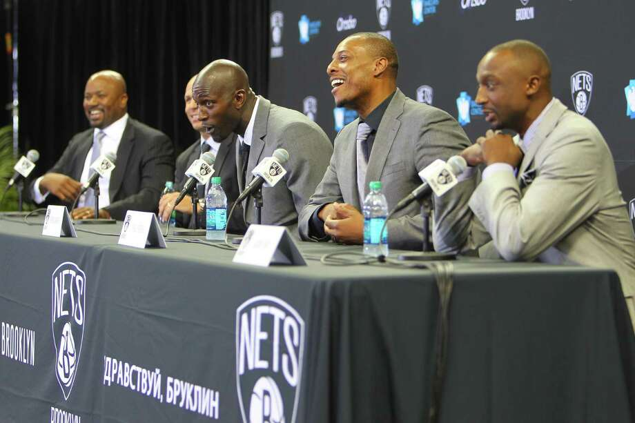 From left: Brooklyn Nets General Manager Billy King, Head Coach Jason Kidd and newly acquired Brooklyn Nets players Kevin Garnett, Paul Pierce and Jason Terry during a new conference at the Barclays Center, New York, July 18, 2013. The Nets officially acquired them as part of a nine-player trade with the Boston Celtics. (Chang W. Lee/The New York Times) ORG XMIT: XNYT87 Photo: CHANG W. LEE / NYTNS