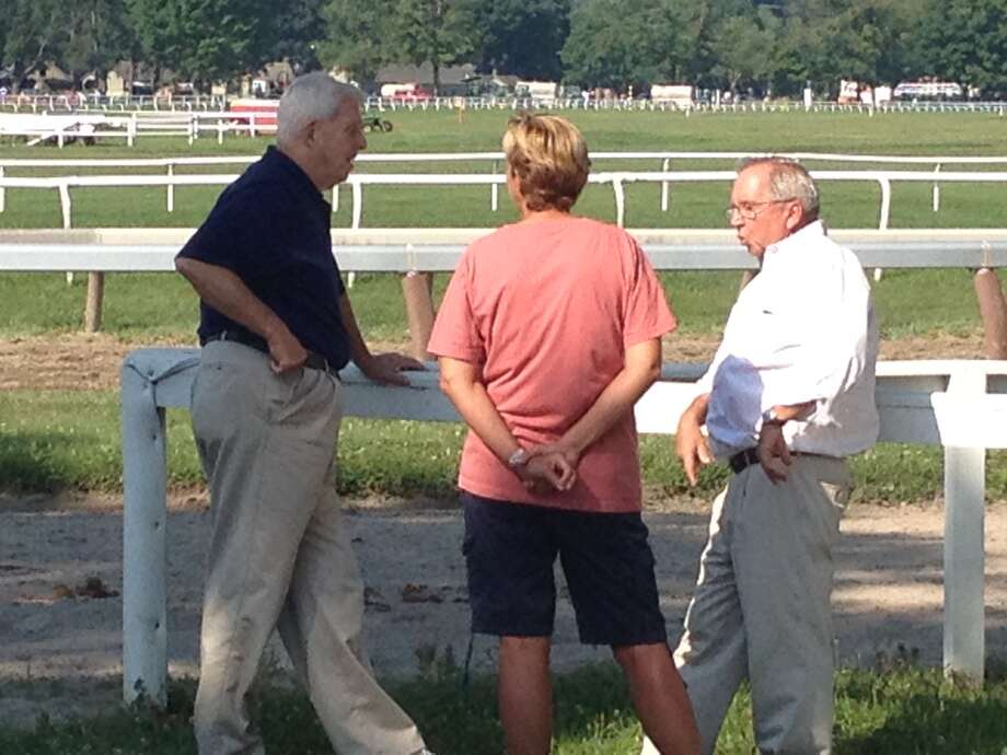 Former Giants football coach Bill Parcells chats with trainer Shug McGaughey and McGaughey's wife, Alison, as the Oklahoma Training Track on Thursday, July 18, 2013. (Tim Wilkin / Times Union)