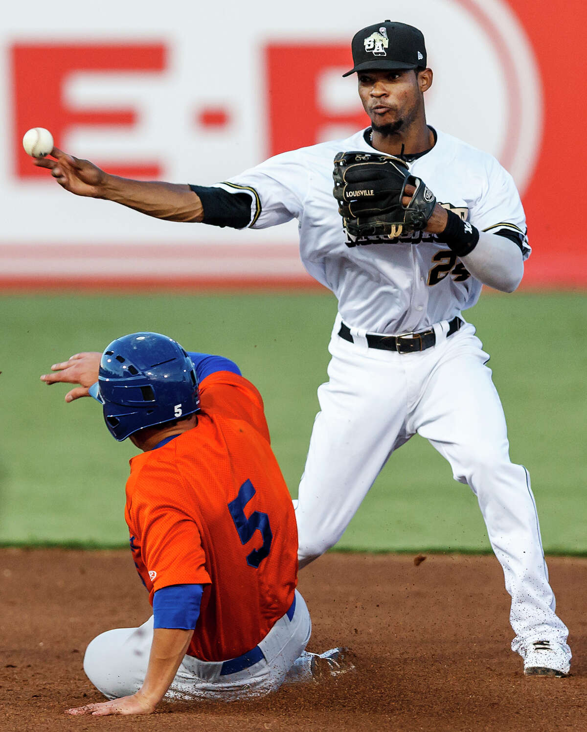 Jeudy Valdez of the Missions (right) throws to first base to complete a double play after forcing out Midland's Chad Oberacker at second during the fifth inning of their game with the Midland Rockhounds at Wolff Stadium on Thursday, July 18, 2013. Midland beat the Missions 3-1. MARVIN PFEIFFER/ mpfeiffer@express-news.net