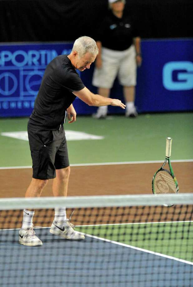 John McEnroe of the New York Sportimes slams his racket to court while playing against the Orange County Breakers in a World Team Tennis match at SEFCU Arena in Albany, N.Y., Thursday, July 18, 2013. (Hans Pennink / Special to the Times Union) ORG XMIT: HP105 Photo: Hans Pennink / Hans Pennink