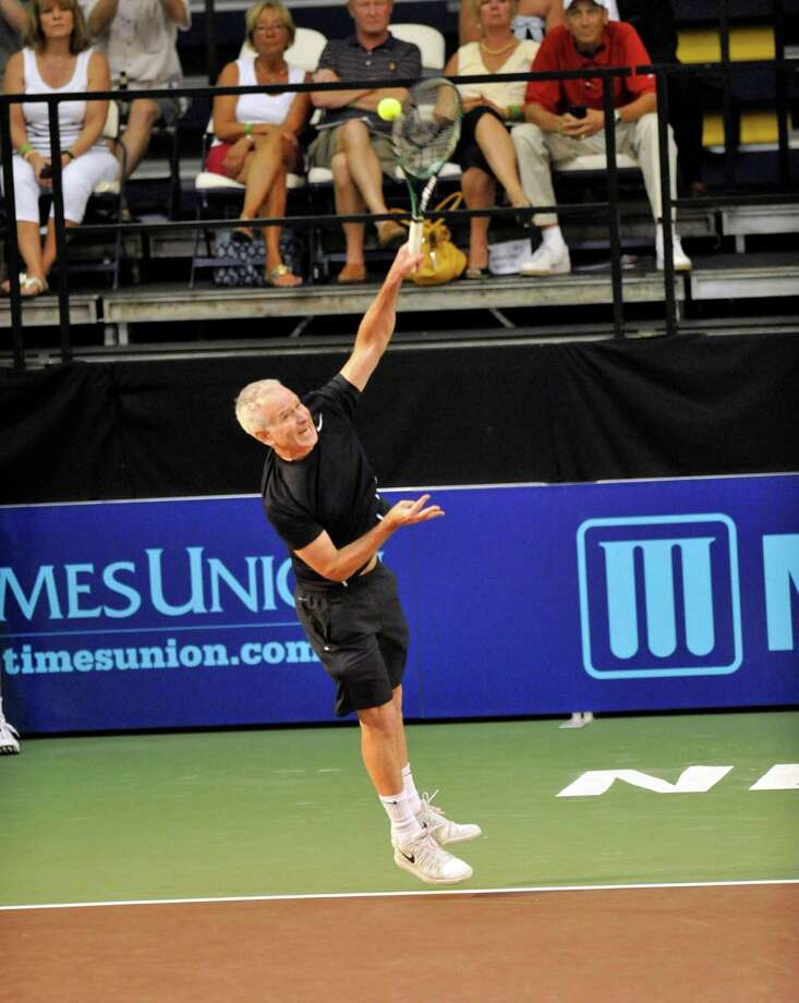 John McEnroe of the New York Sportimes serves the ball against the Orange County Breakers in a World Team Tennis match at SEFCU Arena in Albany, N.Y., Thursday, July 18, 2013. (Hans Pennink / Special to the Times Union) ORG XMIT: HP114 Photo: Hans Pennink / Hans Pennink