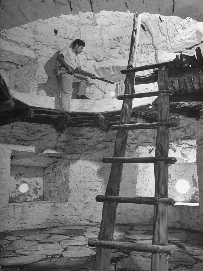 Old, handmade ladder, with round sticks as cross-pieces fitted into rough tree trunks of small diameter and held with wooden peg, leading to upper level of fortification of Mission San José on Oct. 1, 1946. Photo: Cornell Capa, Time & Life Pictures / Getty Images / Time Life Pictures