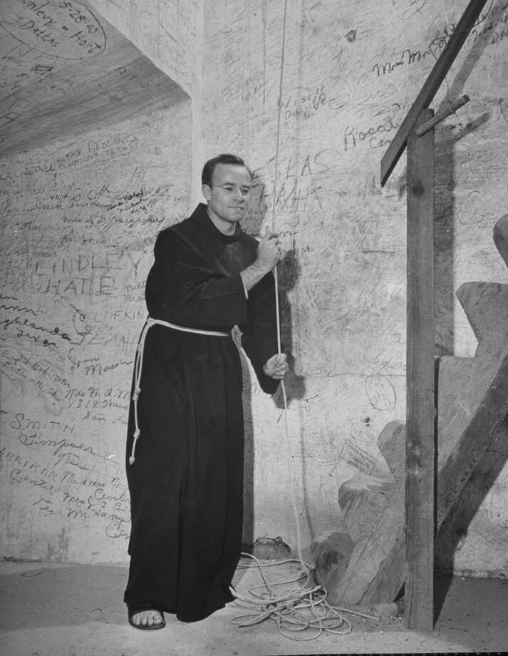 Mission San José, restored, used as church and historic site, showing a monk ringing the tower bell on Oct. 1, 1946. Photo: Cornell Capa, Time & Life Pictures / Getty Images / Time Life Pictures