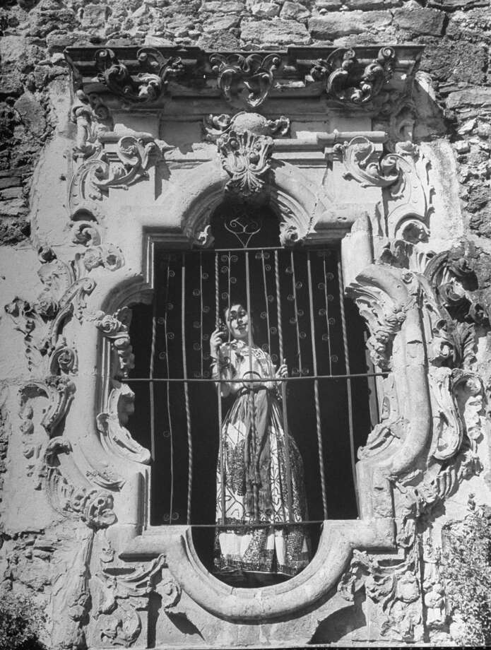Mission San José, restored, used as church and historic site, showing an elaborately decorated arched window at a sunlit walk on Oct. 1, 1946. Photo: Cornell Capa, Time & Life Pictures / Getty Images / Time Life Pictures