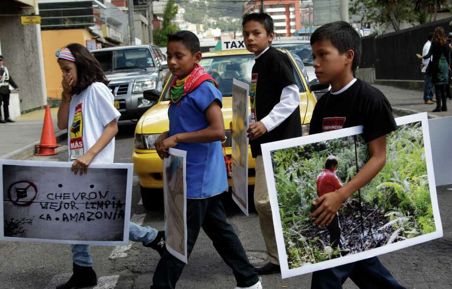 Children from the Amazon region take part in a protest Thursday against Chevron Corp. in Quito, Ecuador. Plaintiffs are pressing to collect on an $19 billion pollution judgment against the oil company. Photo: Dolores Ochoa, STF / AP