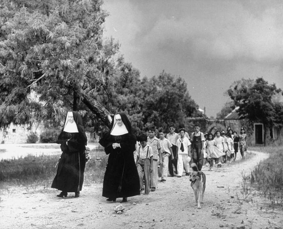Nuns leading children of Mission Espada school across grounds to the chapel on Dec. 31, 1944. Photo: Alfred Eisenstaedt, Time & Life Pictures / Getty Images / Time & Life Pictures/Getty Images