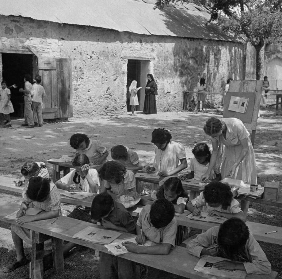 Summer catechism class held outdoors at Mission San Juan on Dec. 31, 1944. Photo: Alfred Eisenstaedt, Time & Life Pictures / Getty Images / Time & Life Pictures/Getty Images