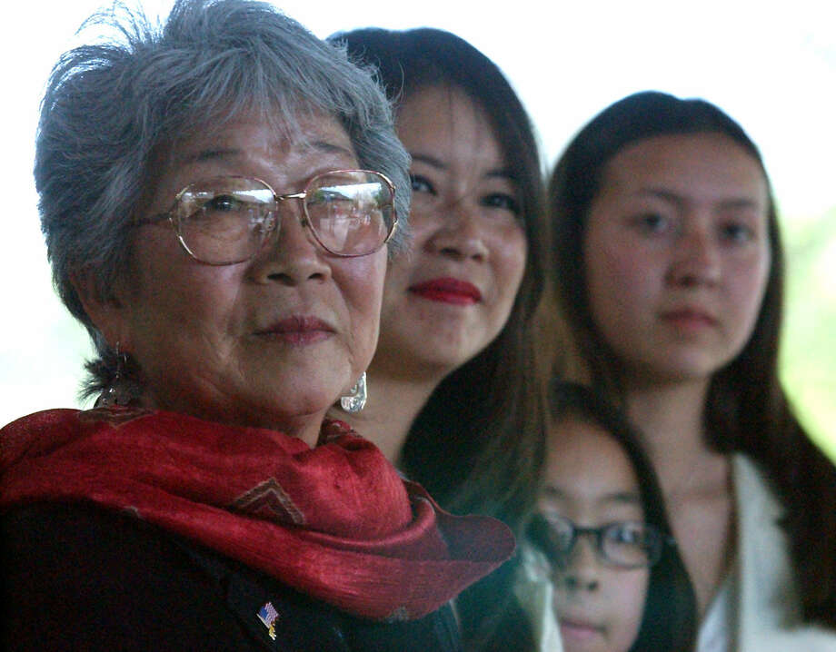 Mabel Jingu Enkoji (left) with daughter Peggy Nishio and granddaughters Stefanie Nishio and Miyoshi Busch at a Japanese Tea Garden ceremony in 2002. Photo: San Antonio Express-News / File Photo