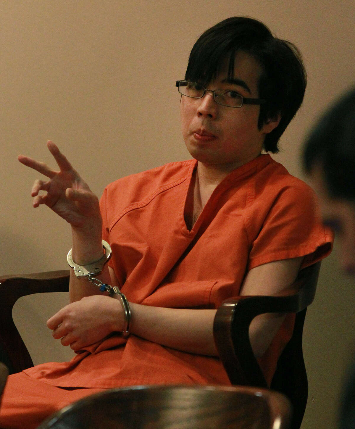Defendant Yu Masaki, who pleaded guilty in March, sits in the 144th District Court prior to sentencing Thursday.