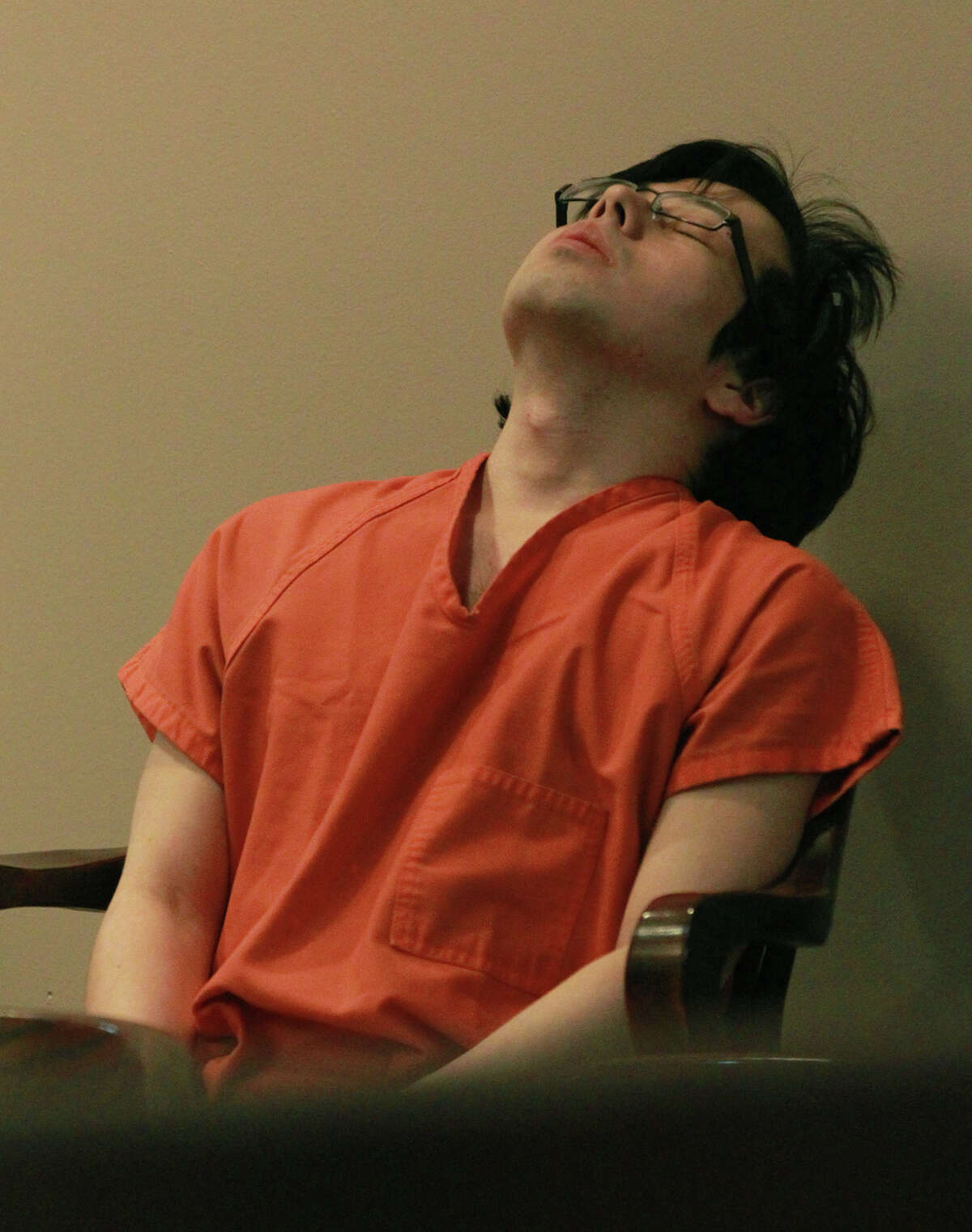 """Defendant Yu Masaki leans back in the 144th District Court prior to sentencing Thursday July 18, 2013. Masaki pleaded guilty in March to shooting and killing Juan Carlos """"J.C."""" Escamilla and also shooting and wounding Margaret """"Maggie McCombs. Masaki received a life sentence for the crimes."""