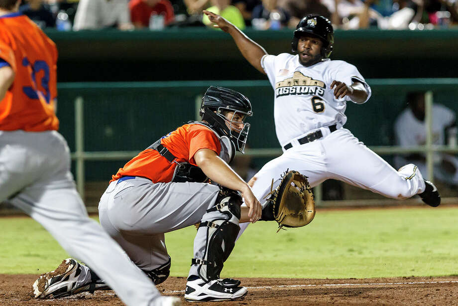 The Missions' Johan Limonta (right) slides into home as Midland catcher Davie Frietas waits for the throw during the seventh inning of the Missionsduring their game with the Midland Rockhounds at Wolff Stadium on Thursday, July 18, 2013. Midland beat the Missions 3-1.  MARVIN PFEIFFER/ mpfeiffer@express-news.net Photo: Marvin Pfeiffer, San Antonio Express-News / Express-News 2013