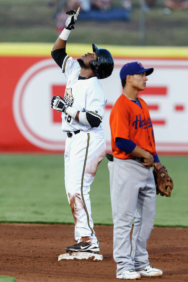 Yeison Asencio of the Missions points to the sky after reaching second base on a double during the fifth inning of their game with the Midland Rockhounds at Wolff Stadium on Thursday, July 18, 2013.  Midland won the game 3-1.  MARVIN PFEIFFER/ mpfeiffer@express-news.net Photo: Marvin Pfeiffer, San Antonio Express-News / Express-News 2013