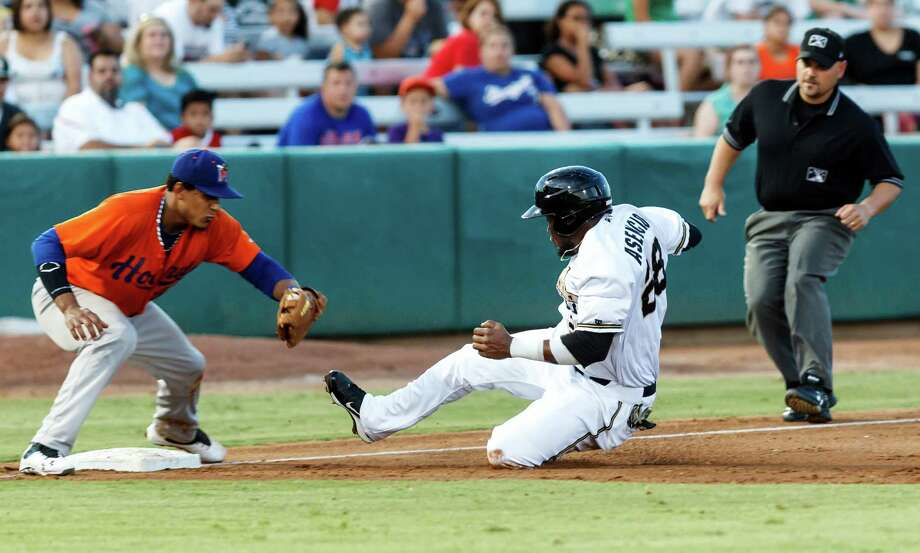 Yeison Asencio of the Missions (center) slides into third as Midland's Jefry Marte (left) waits to tag him out during the fifth inning of their game with the Midland Rockhounds at Wolff Stadium on Thursday, July 18, 2013.  Midland won the game 3-1.  MARVIN PFEIFFER/ mpfeiffer@express-news.net Photo: Marvin Pfeiffer, San Antonio Express-News / Express-News 2013