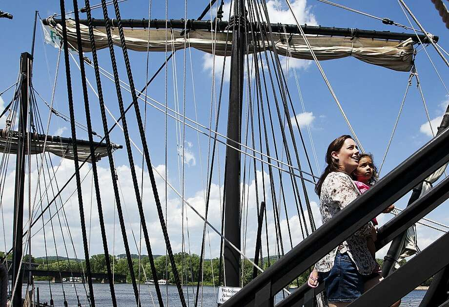Lynn and Laura, 3, Ramnanan of Atlanta, walk up to an upper deck on the Pinta replica ship during a visit with family Thursday, July 18, 2013, at Levee Park in Winona, Minn. The Pinta and Nina ships will be docked in Winona for visitors through Wednesday, July 24. (AP Photo/Winona Daily News, Andrew Link) Photo: Andrew Link, Associated Press