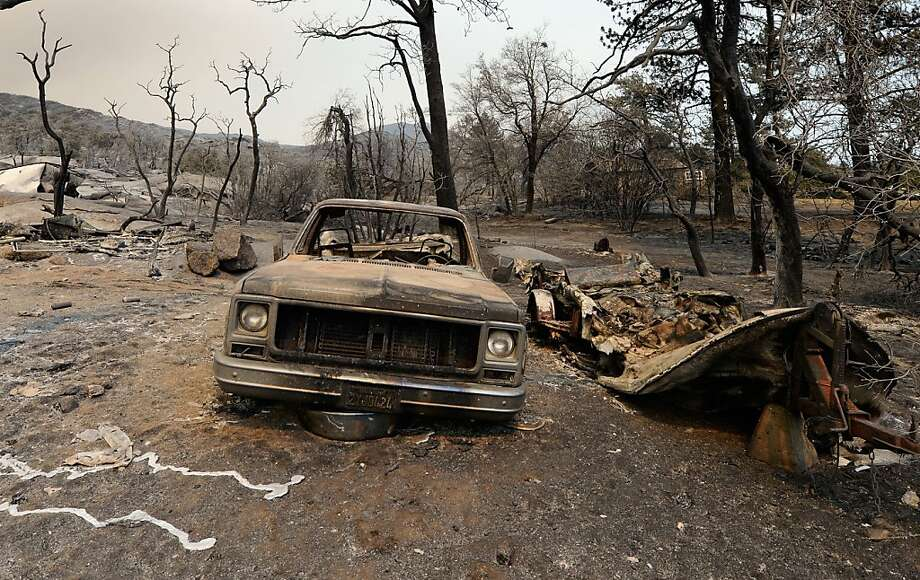 IDYLLWILD, CA - JULY 18:  A pickup is shown in the wake of  the Mountian Fire after it scorched the area on July 18, 2013 near Idyllwild, California. The massive wildfire in Riverside county has grown to 23,000 acres and is advancing towards the mountain town of Idyllwild on one front and city of Palm Springs on the other front destroying several homs and forcing the evacuation of 6,000 people.  (Photo by Kevork Djansezian/Getty Images) Photo: Kevork Djansezian, Getty Images