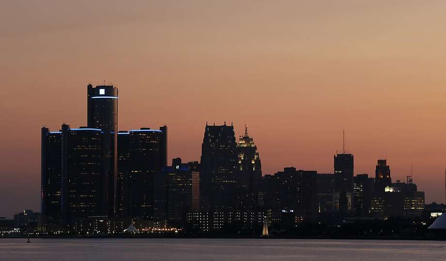 The sun sets on Detroit, Thursday, July 18, 2013. State-appointed emergency manager Kevyn Orr asked a federal judge permission to place Detroit into Chapter 9 bankruptcy protection Thursday. (AP Photo/Paul Sancya) Photo: Paul Sancya, Associated Press