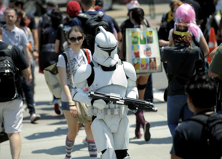 A Stormtrooper makes his way through the crowd during Day 2 of Comic-Con International on Thursday, July 18, 2013 in San Diego, Calif. (Photo by Chris Pizzello/Invision/AP) Photo: Chris Pizzello, Associated Press